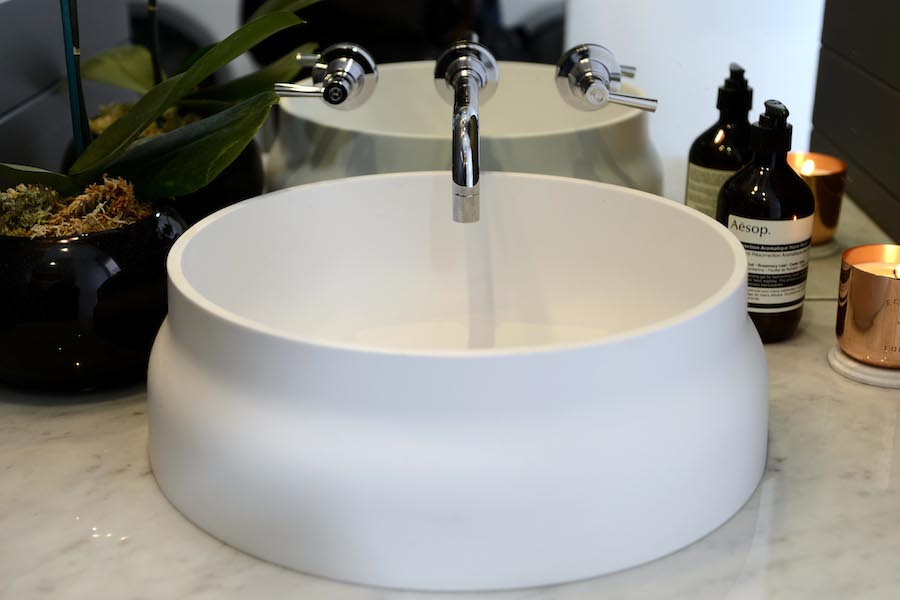 Dee's white sink in powder room