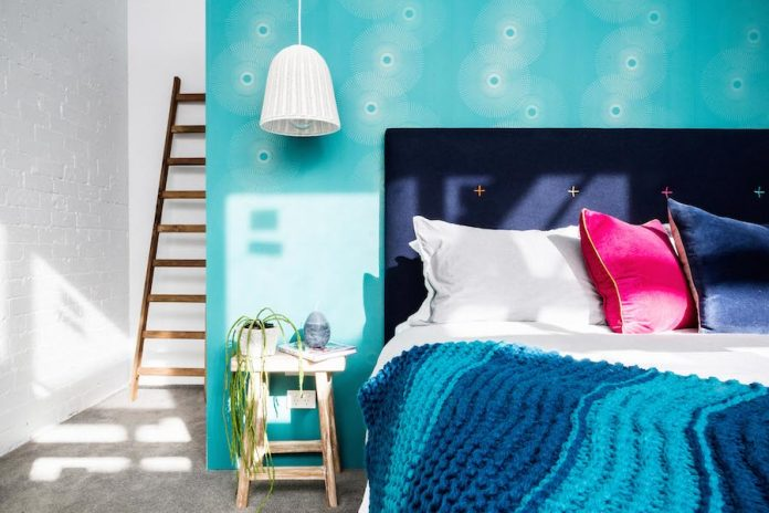 Fun teal blue wallpaper in Michael and Carlene's room