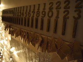 Advent calendar hanging over fireplace
