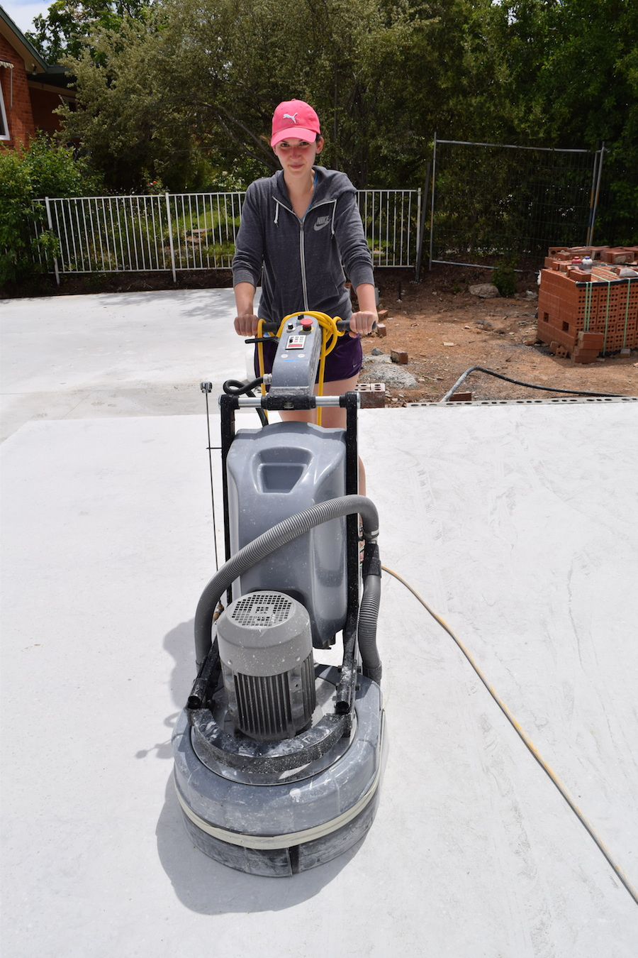 Gina using the concrete machine