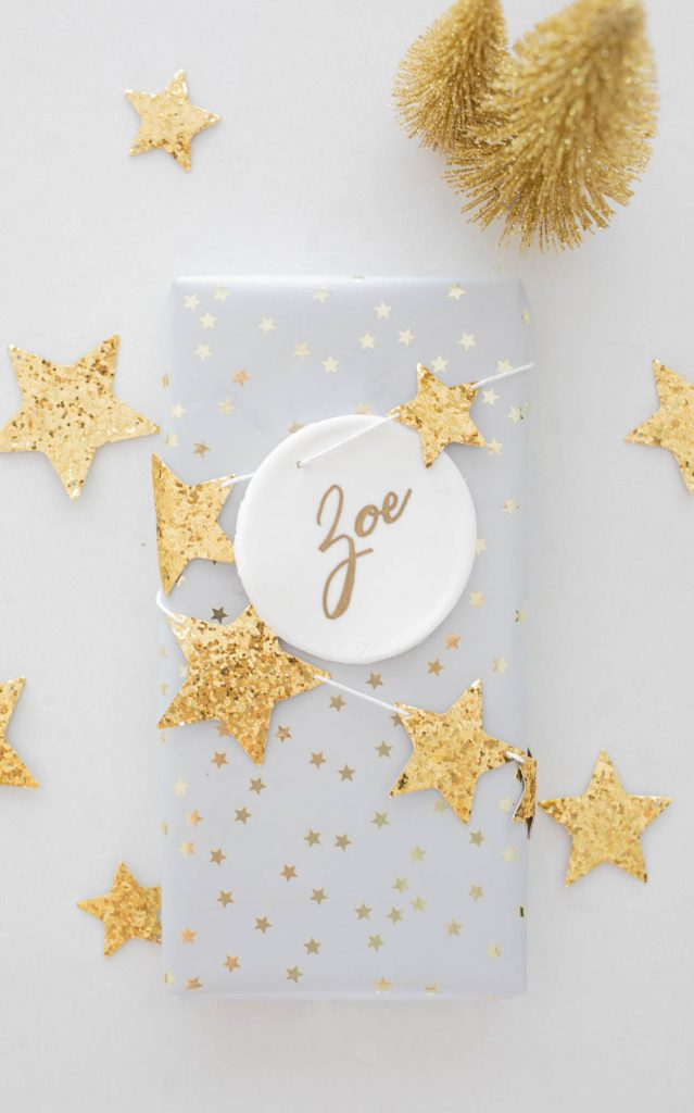 Gold star gift wrapping with DIY Christmas clay ornament