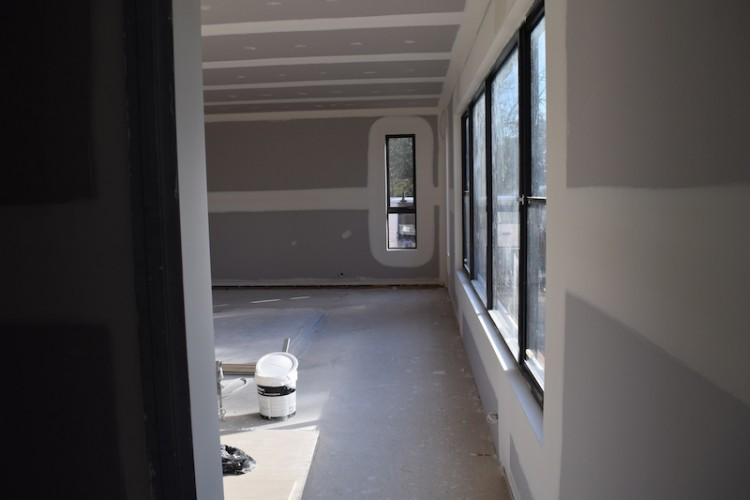 Looking from living area past pantry into kitchen and dining