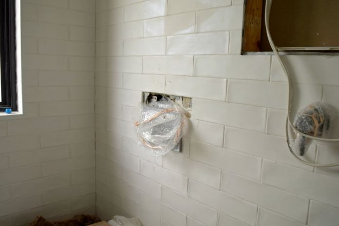 Removing tiles in the ensuite to fix the leak