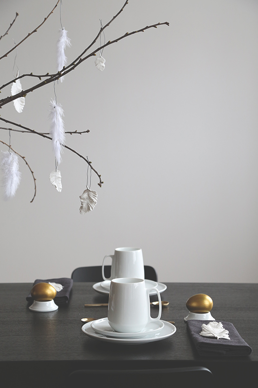 Black white and brass Easter table setting