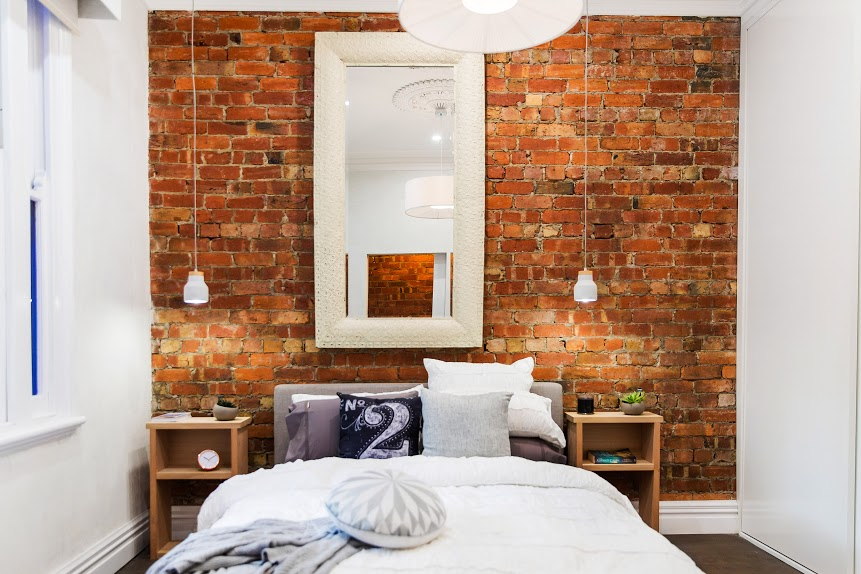 Bedroom with exposed red brick