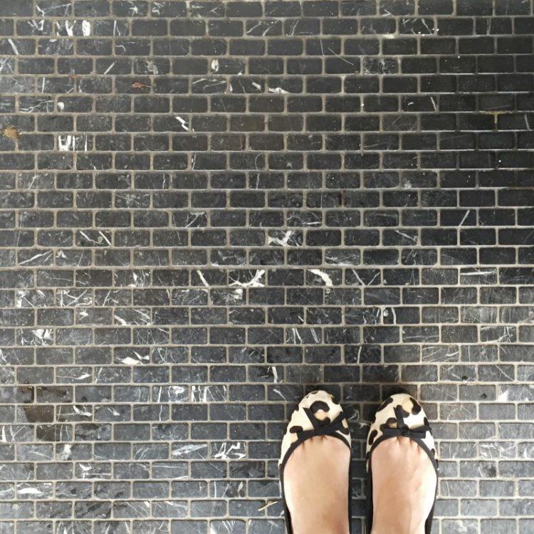 Black marble tiles at Urban Pantry