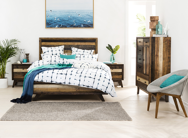Crisp queen bed, bedside tables and tall boy