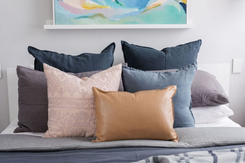Arranging cushions on bed