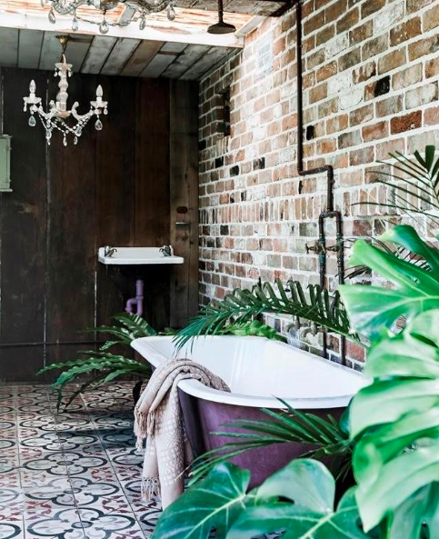 Brick and wood with patterned tile bathroom