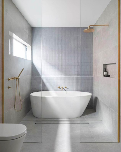 Bathrooms that don't use white tiles grey bathroom with standalone bath