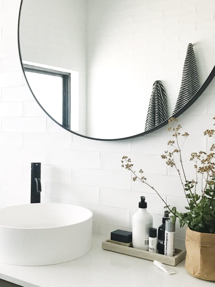 Bathroom vanity with round mirror