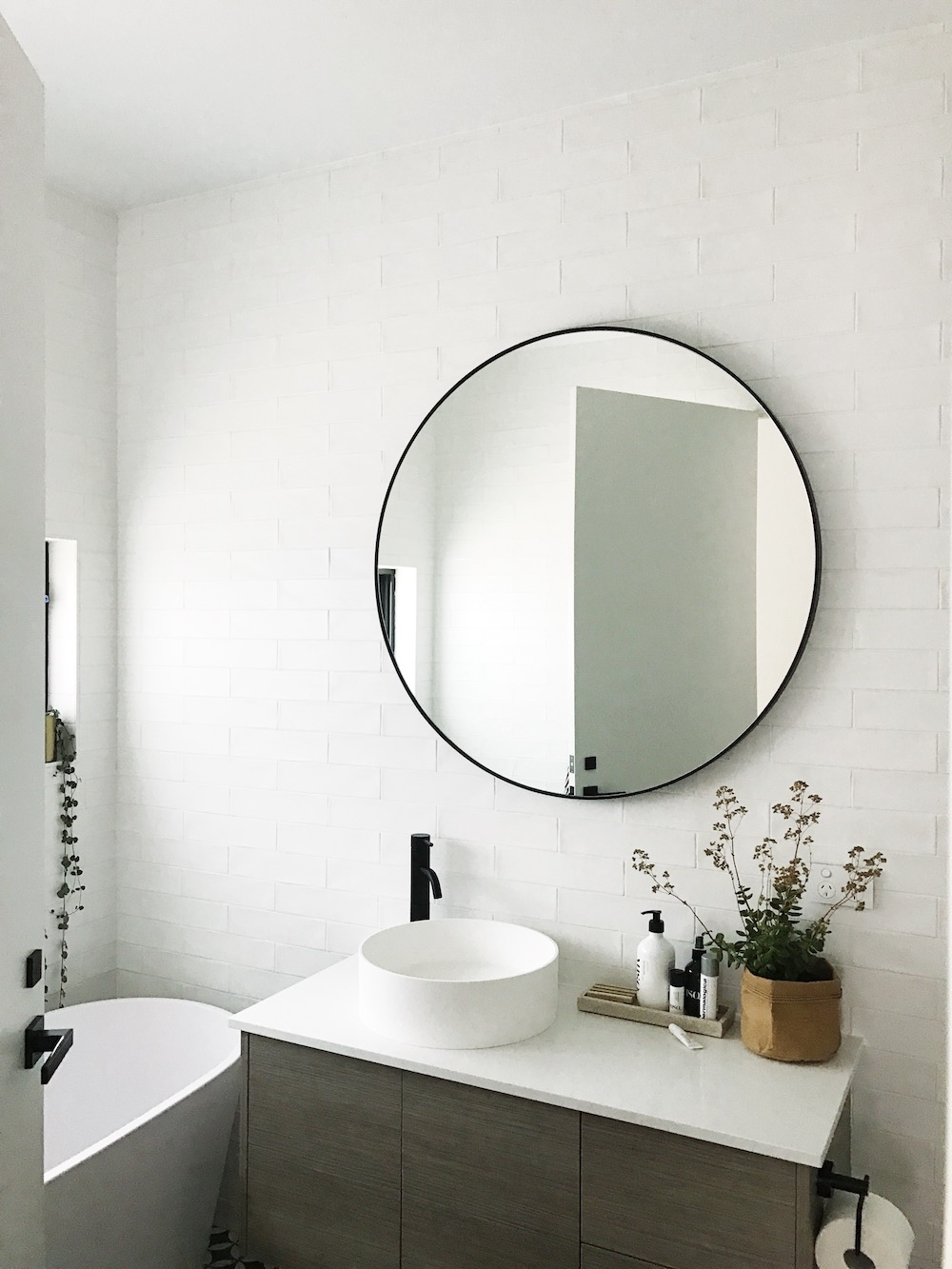 Gina 39 s home black and white bathroom reveal style curator - Round mirror over bathroom vanity ...