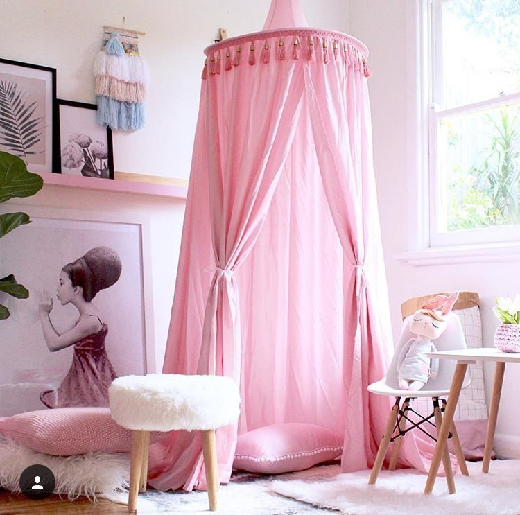 Pink canopy in girls bedroom