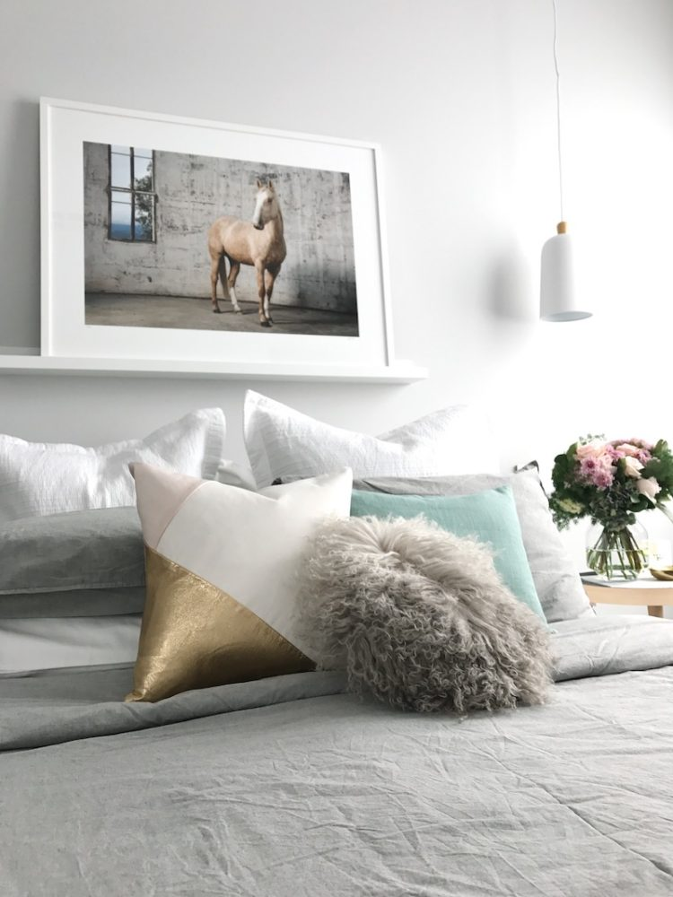 Contemporary luxe bed styling