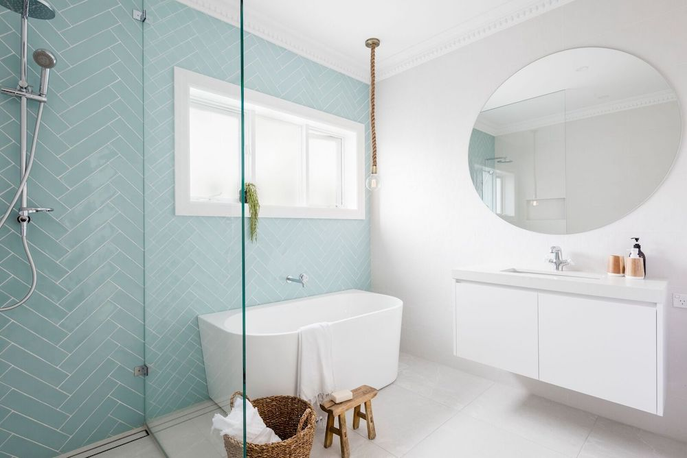 Blue herringbone subway tile wall