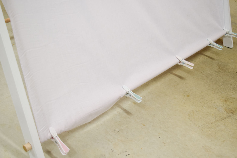 Peg fabric into place
