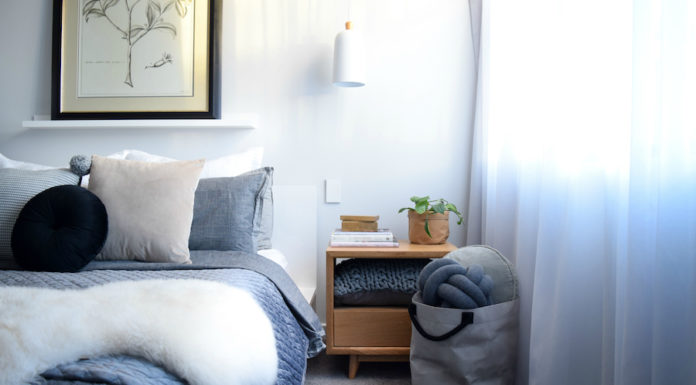 Cushions in a basket by bed