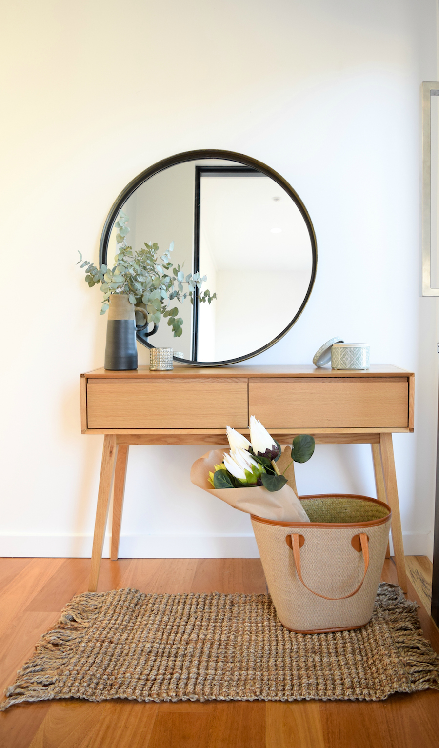 Round mirror in entry