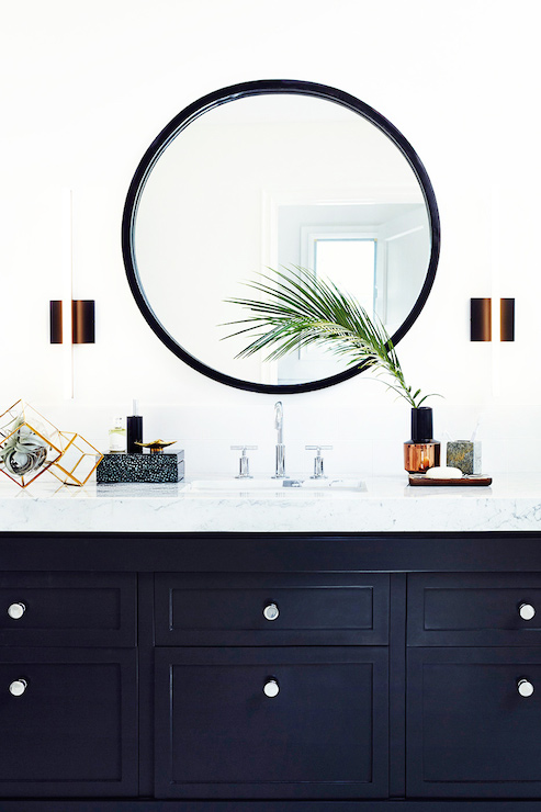 Black round mirrors and black bathroom vanity