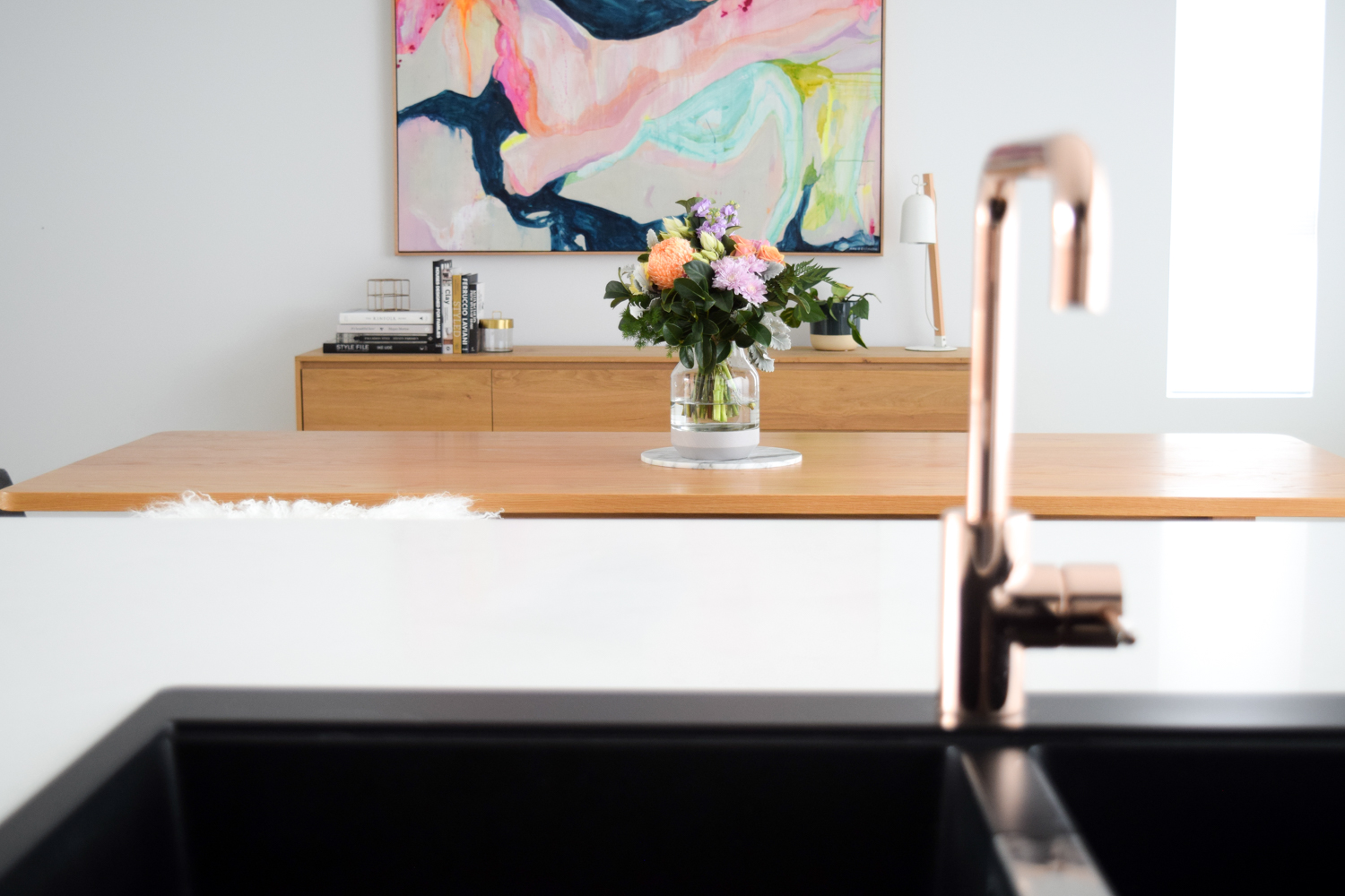 Dining area with large abstract art How to style your sideboard