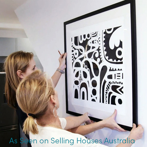 Shaynna Blaze hanging art on Selling Houses Australia