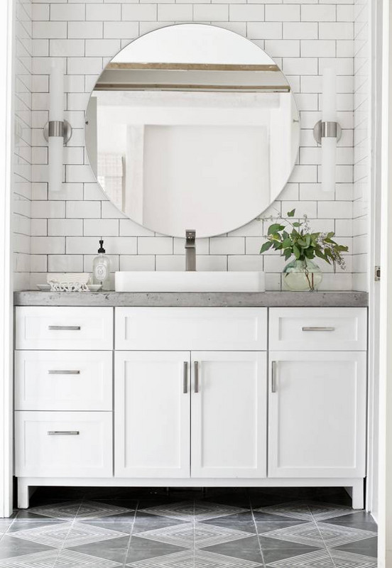 White bathroom with concrete vanity bench