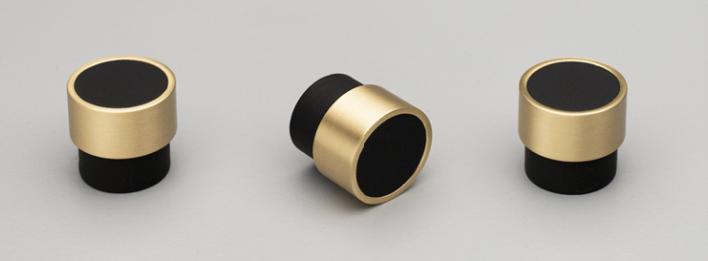 Round brass and black handles