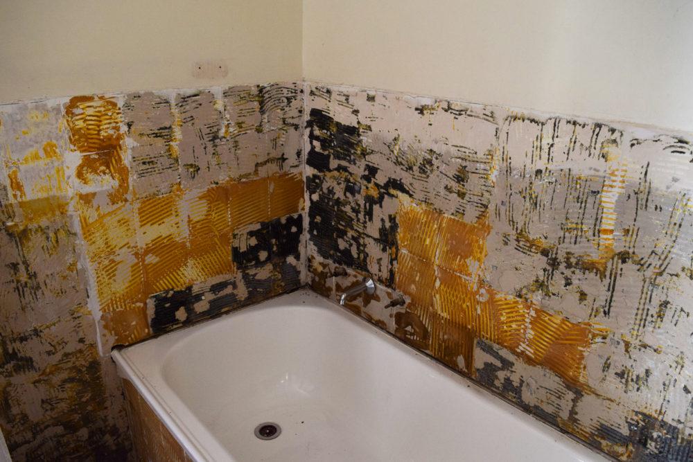 Removed old tiles around bathtub