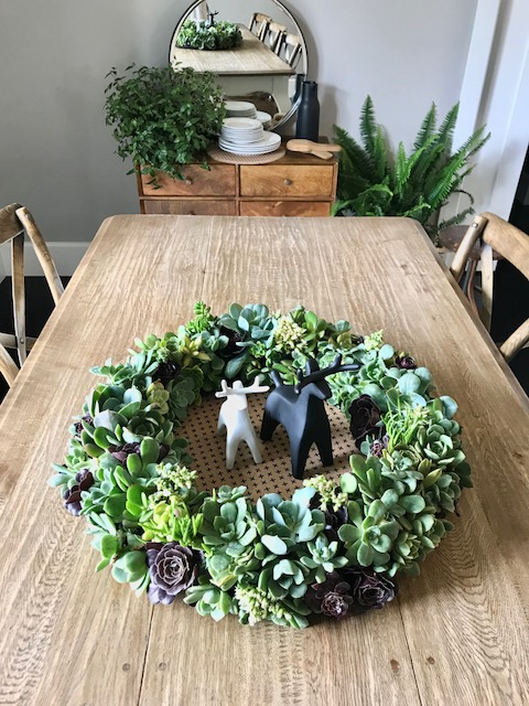 Succulent wreath on the table
