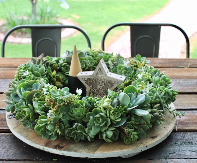 Succulent wreath on an outdoor table