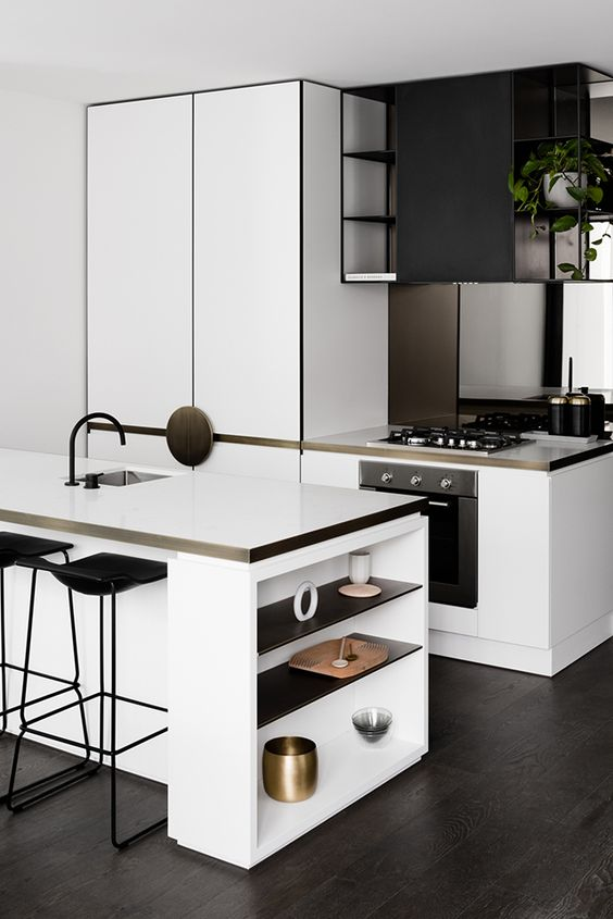 Black and white kitchen with brass edging