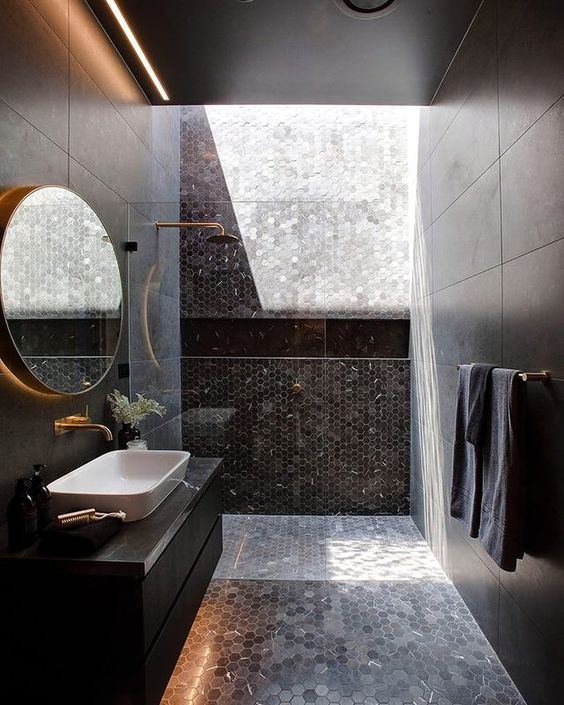 Black bathroom with metallic accents