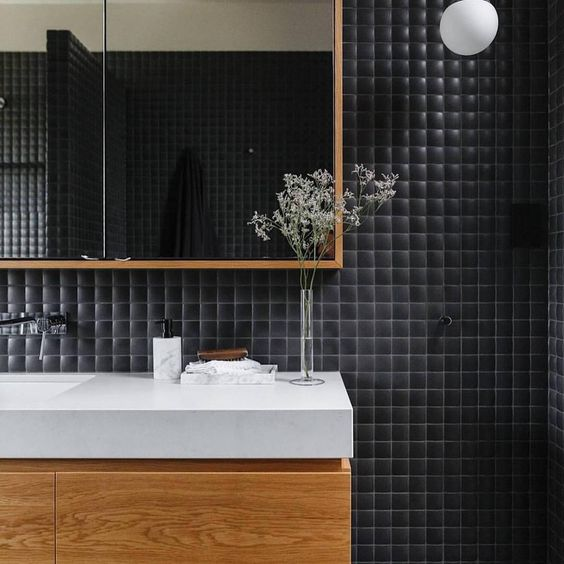 Curved black mosaic tile