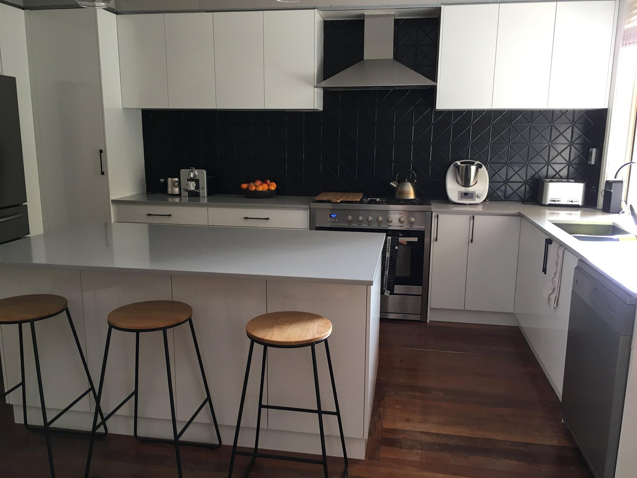 Black pressed metal splashback