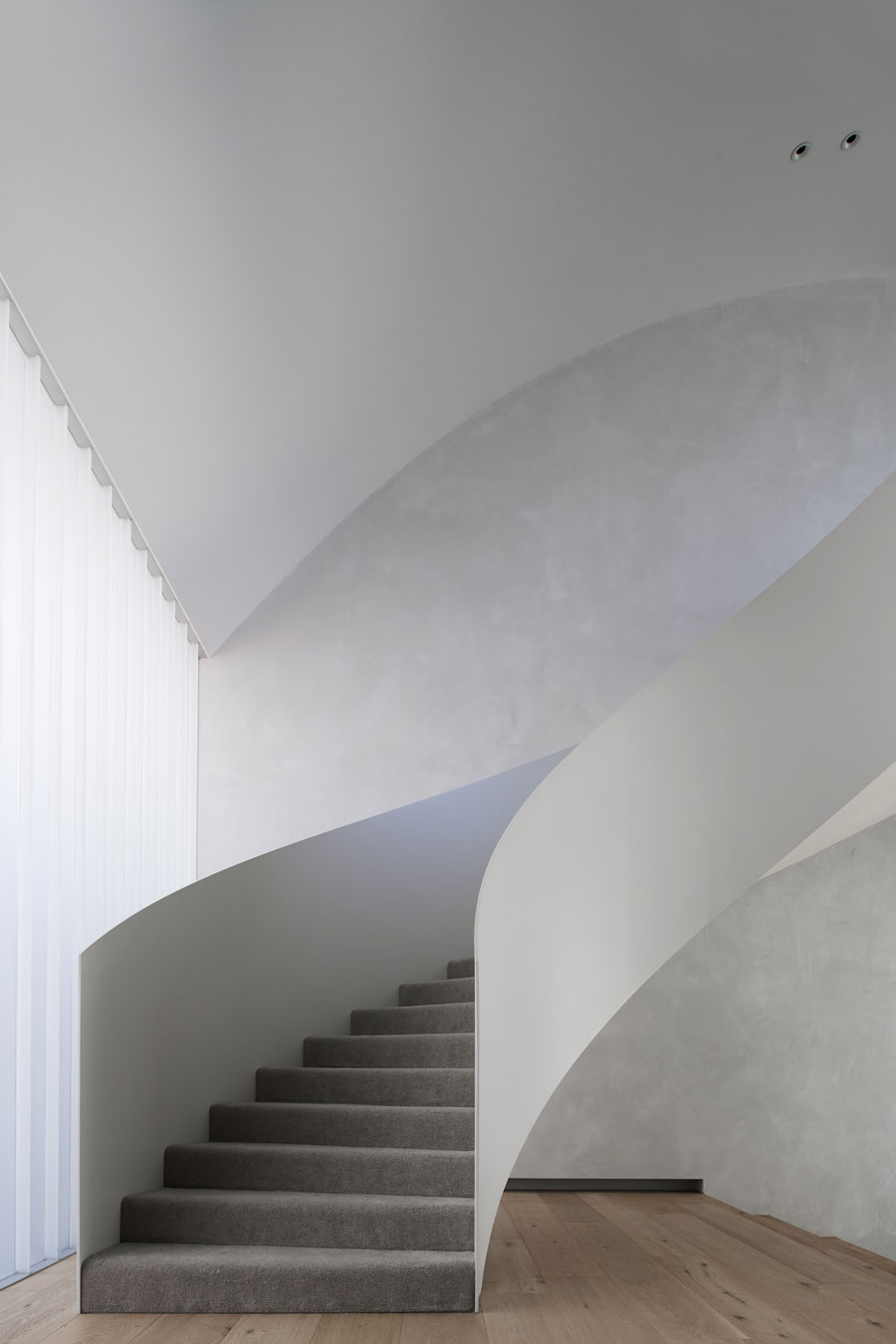 Grey and white spiral staircase