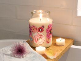 Burning candle on shelf