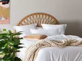 Chunky knit throw on rattan bed