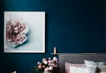Dusty pink bedding and dark blue wall