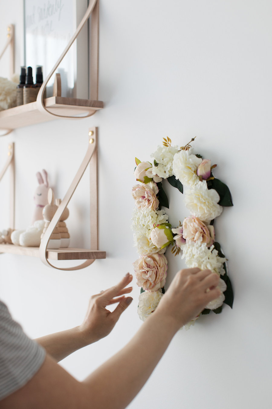 Attach floral letter wall art to wall