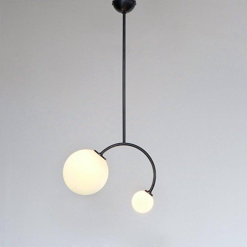 Curved spherical pendant light