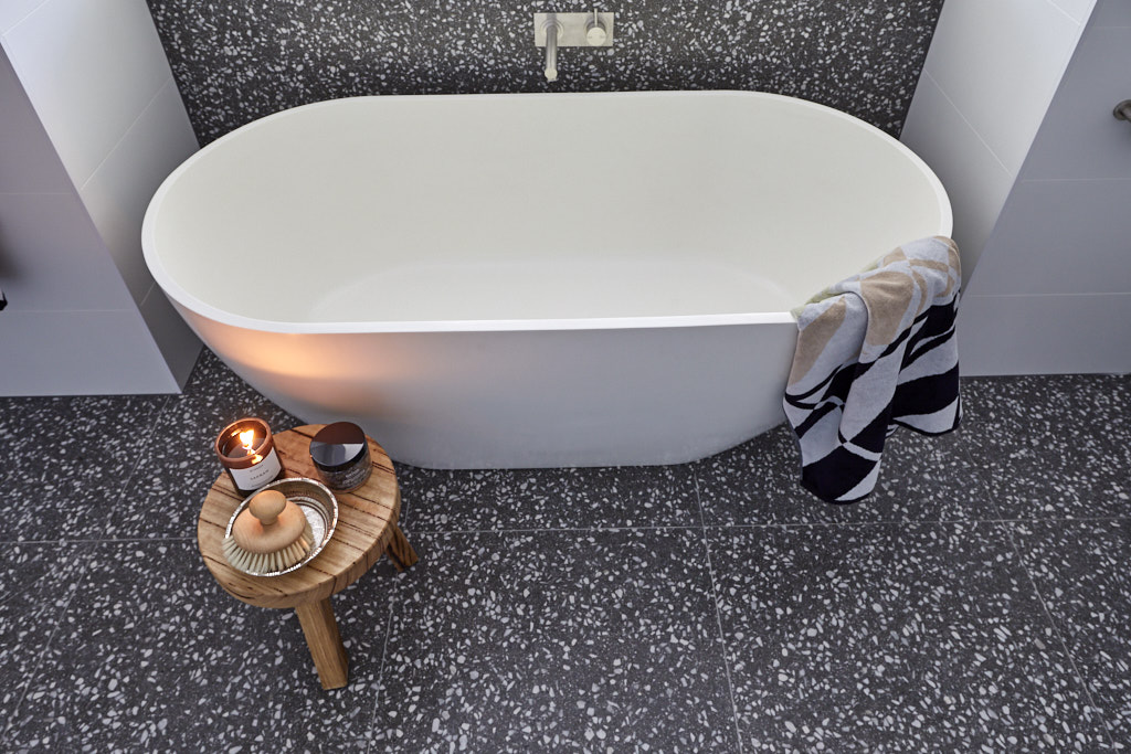 Freestanding bath on terrazzo floor