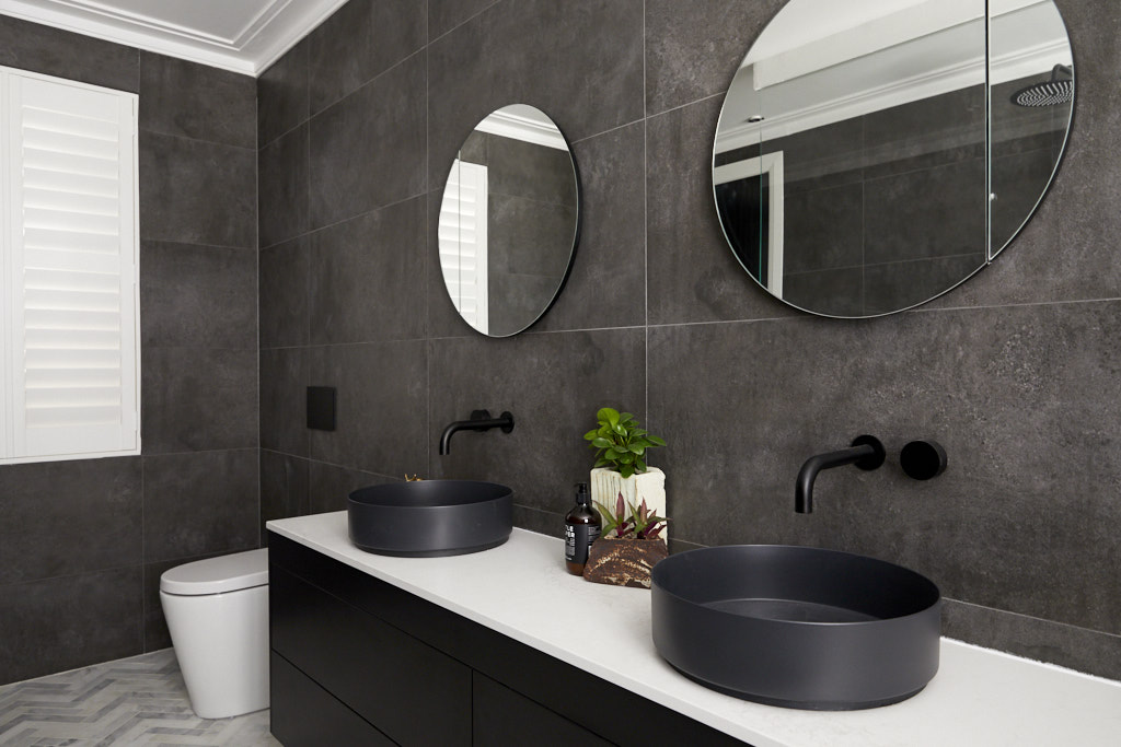 Black vanity with black basins