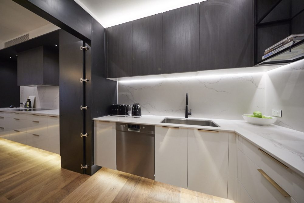 Black overhead kitchen cabinets