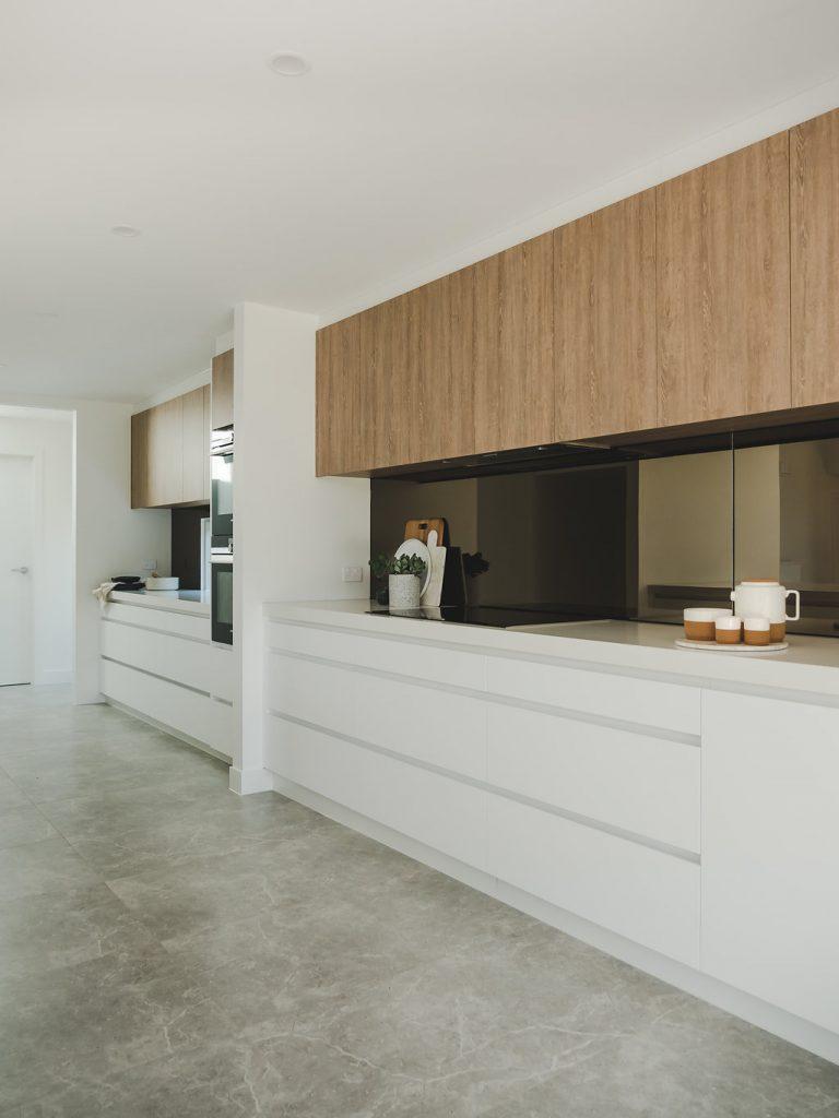 Oversized kitchen with tempered mirror splashbacks