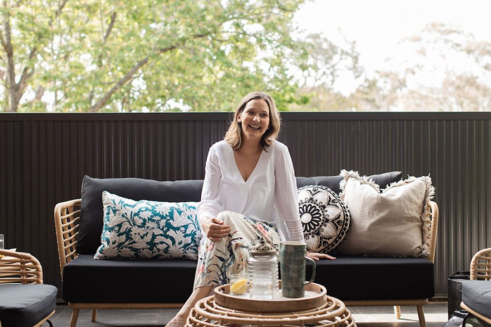 Gina in outdoor living room celebrating 5 years of Style Curator