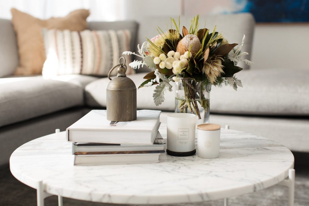 Scented candle coffee table styling