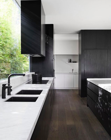 Rangehood over large glass window Black kitchens