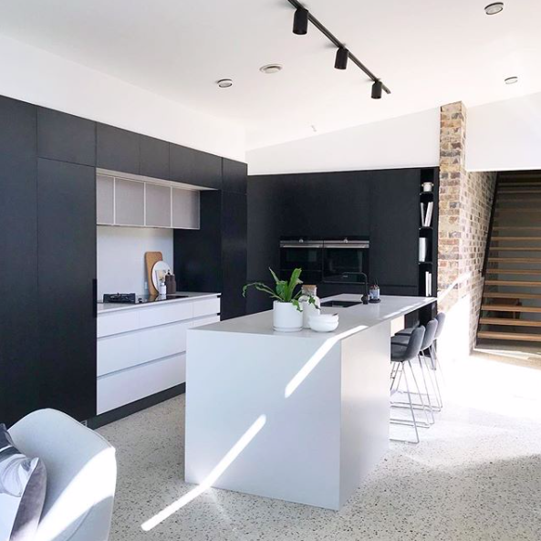 Black and white kitchen with perforated steel detail