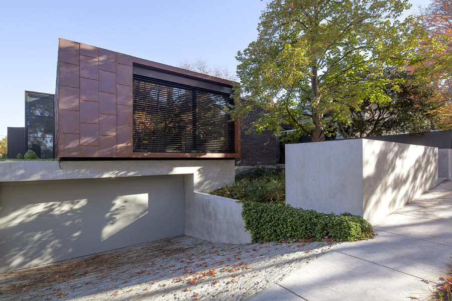 Rock driveway on metal clad house