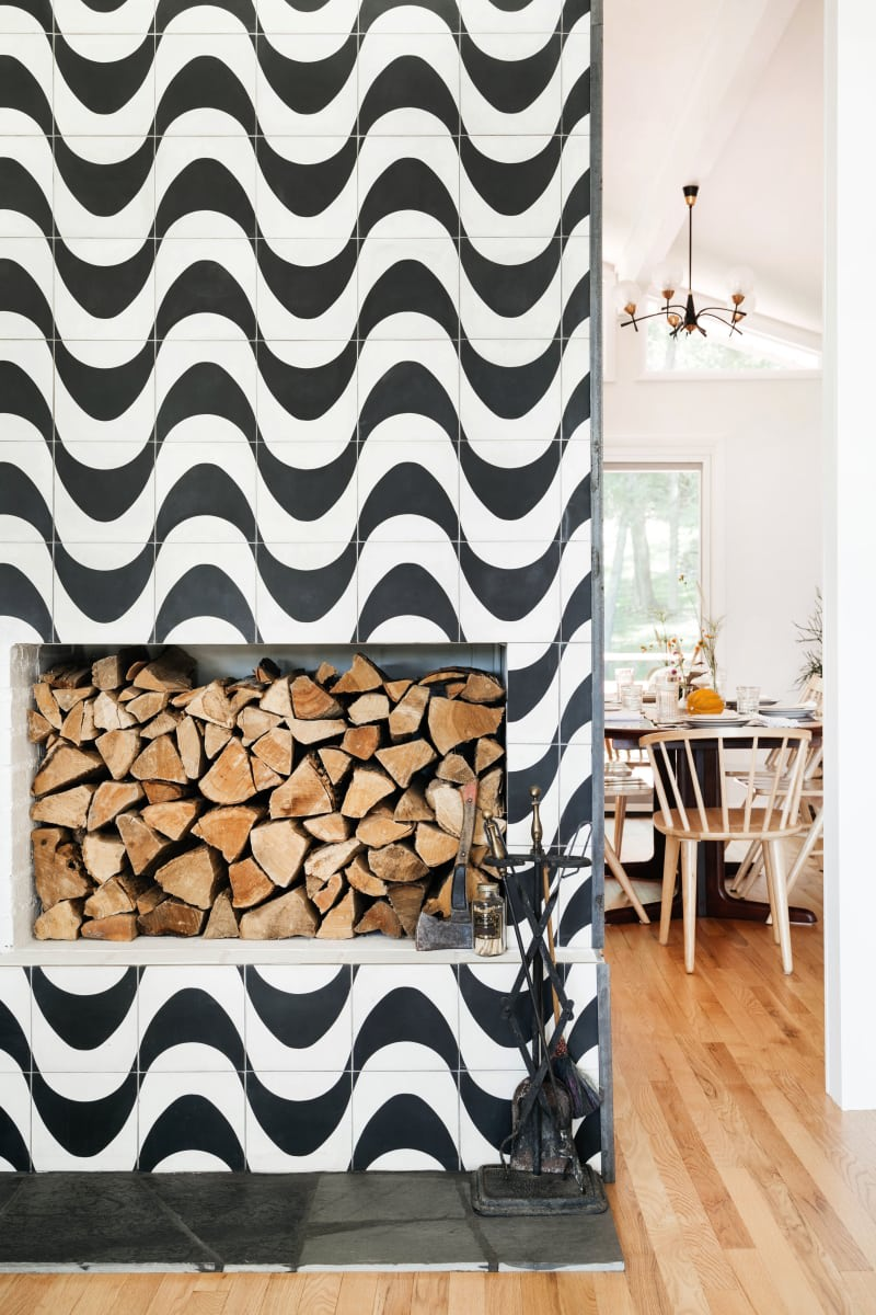Black and white wave pattern tile around fireplace